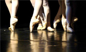 Close up of legs and feet in ballet slippers on pointe
