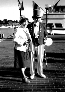 Naturalization ceremony. Uncle Sam with a woman participant, Baltimore, July 1986. Source: United States Customs and Immigration Services History Office and Library.