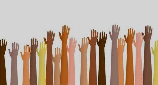 Image includes arms of various races reaching up