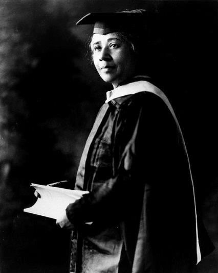 Black and white photograph of Ann Julia Cooper in academic dress