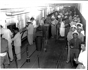Processing line for Braceros at Immigration, El Paso, Texas, 1955. Source: United States Customs and Immigration Services History Office and Library.