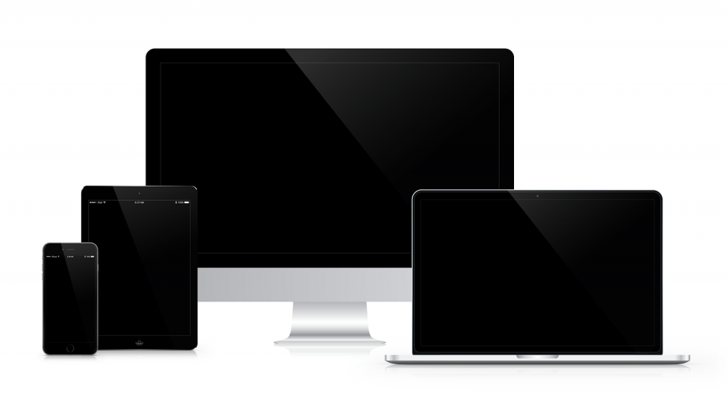 reflective black computer and tablet screens