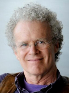 A portrait of Erik Olin Wright smiling.